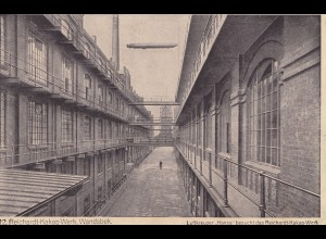Ansichtskarte: Wandsbek-Kakao Werk mit Luftkreuzer Hansa-Luftschiff